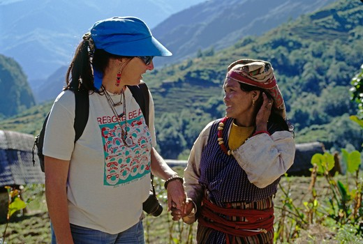 Stock Photo: 1886-56264 Christine makes friends in the SHERPA village of UPPER WALENG on the return journey from MAKALU - NEPAL