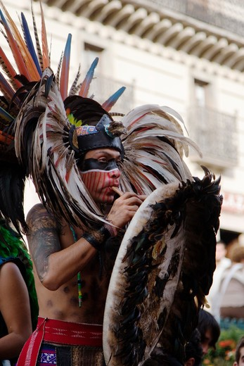 Stock Photo: 1886-56360 An AZTEC DANCER performs in a traditional warrior feathered COSTUME during the CERVANTINO FESTIVAL  - GUANAJUATO, MEXICO