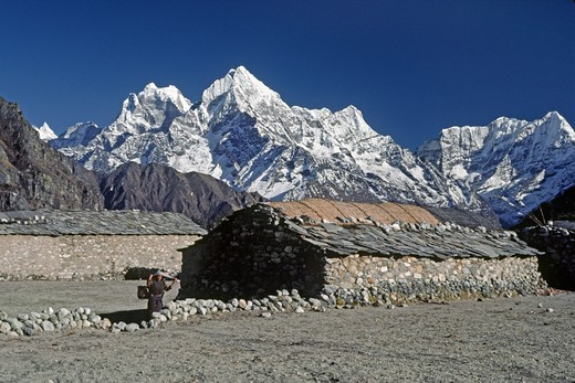 Stock Photo: 1886-56498 Sherpa house in the village of Thame with Kyajo Ri  (left) & Khumbila Peak (right) forming a Himalayan backdrop - KHUMBU DISTRICT, NEPAL
