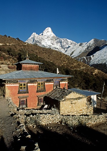 PANGBOCHE MONASTERY with AMA DABLAM PEAK as a beautiful backdrop - Everest Region of the KHUMBU, NEPAL : Stock Photo