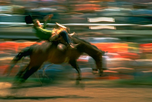 Stock Photo: 1886-56912 Blurred rodeo cowboy