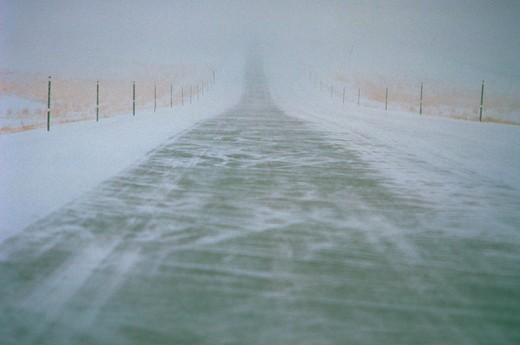 Stock Photo: 1886-56924 Highway in blizzard, WY