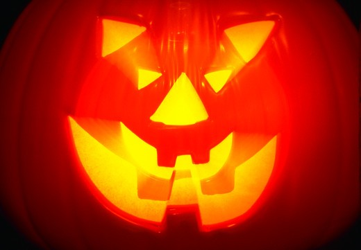 Stock Photo: 1886-56932 Halloween Jack-O-Lantern with blurred light effect.