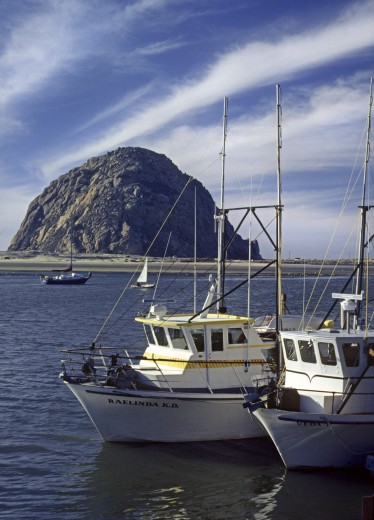 Stock Photo: 1886-5694 FISHING BOATS at anchor in MORRO BAY with MORRO ROCK in the background - CALIFORNIA