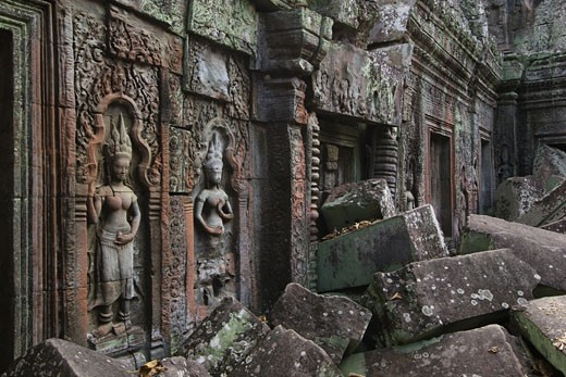 Stock Photo: 1886-5833 Stone carved bas relief  Apsaras (celestial maidens) at Ta Prohm, built by Jayavarman VII & part of the  Angkor Wat temple complex - Siem Reap, Cambodia