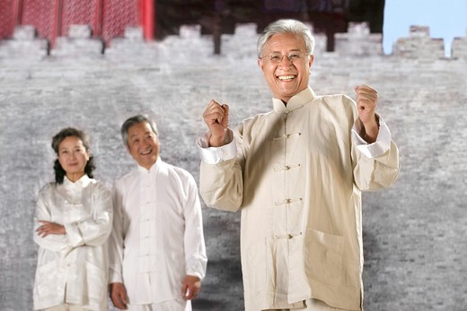Stock Photo: 1886-60410 oriental senior adult doing taijiquan