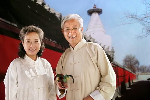Stock Photo: 1886-60414 old couple beside the temple