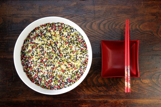 close-up of a bowl of mixed corns and chopsticks : Stock Photo