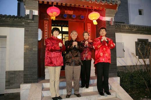 Chinese family making a wish with hands clasped : Stock Photo
