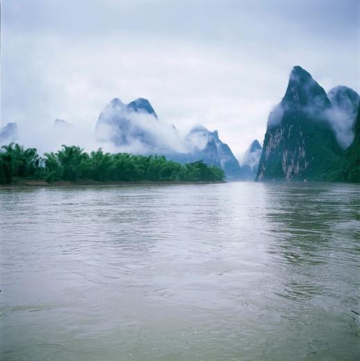 Lijiang River and fog in mountains,Guilin,Guangxi,china : Stock Photo