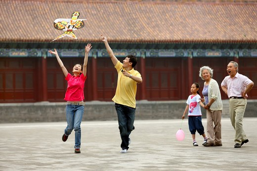 chinese families flying kites in the forbidden city,beijing,china : Stock Photo