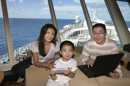 Stock Photo: 1886-63305 Chinese Family Having Holiday On The Cruise Ship