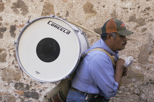 Stock Photo: 1886-6618 Musician carrying base drum to a bull fight in the Plaza de Torres SAN MIGUEL DE ALLENDE, MEXICO