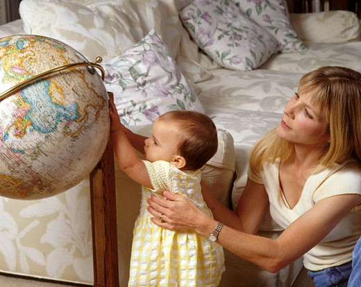 MOTHER gives BABY GIRL her first taste of the world - MODEL RELEASED  : Stock Photo