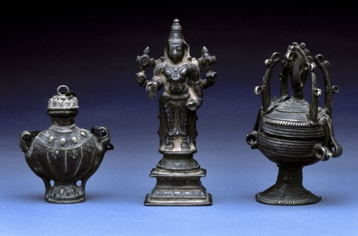 Stock Photo: 1886-7078 ANTIQUE ASIAN METAL STATUE and URNS