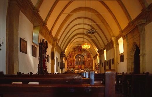 BASILICA interior of the CARMEL MISSION, one of the CALIFORNIA Missions founded by Father JUNIPERO SERRA - CALIFORNIA : Stock Photo