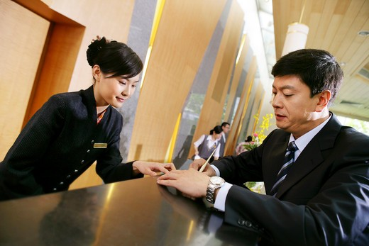 Stock Photo: 1886R-18272 businessman at hotel reception