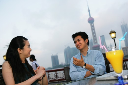 Stock Photo: 1886R-27878 couple resting beside a table on the Bund,Shanghai,China