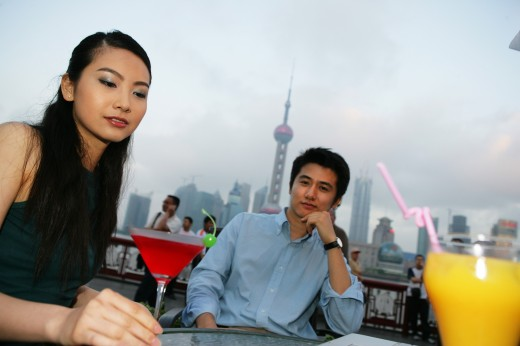 Stock Photo: 1886R-27880 couple resting beside a table on the Bund,Shanghai,China