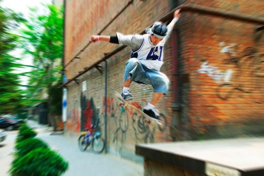 young man skateboarding at 798 Art Zone,Beijing,China : Stock Photo