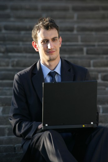 Stock Photo: 1886R-28108 caucasian businessman using laptop on Great Wall,Beijing,China