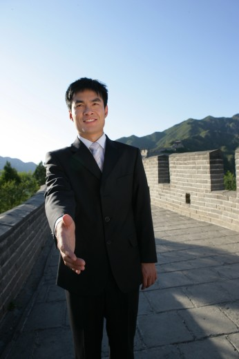 businessman reaching on Great Wall,Beijing,China : Stock Photo