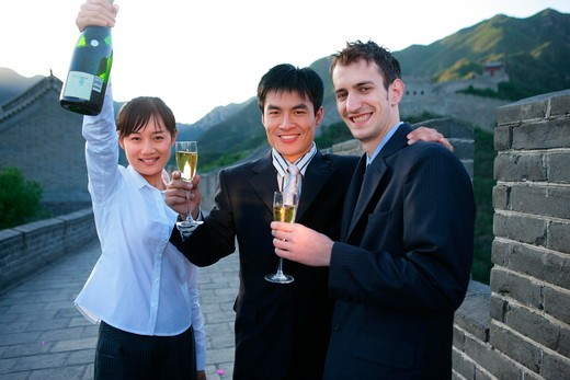 Stock Photo: 1886R-28218 three businessmen and one businesswoman toasting on Great Wall,Beijing,China