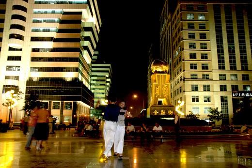 persons dancing at Financial Street at night,Beijing,China : Stock Photo