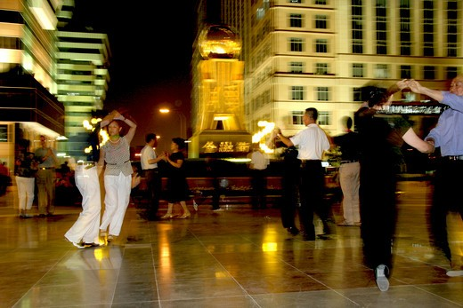 persons dancing at Financial Street at night,Beijing,China : Stock Photo