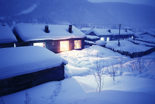 wood house with illuminating window in snow,Snow Country,Shuangfeng forestry centre,Mudanjiang,Heilongjiang,China,night : Stock Photo