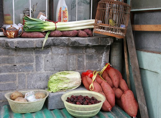 Stock Photo: 1886R-64416 vegetables with other food in paved yard