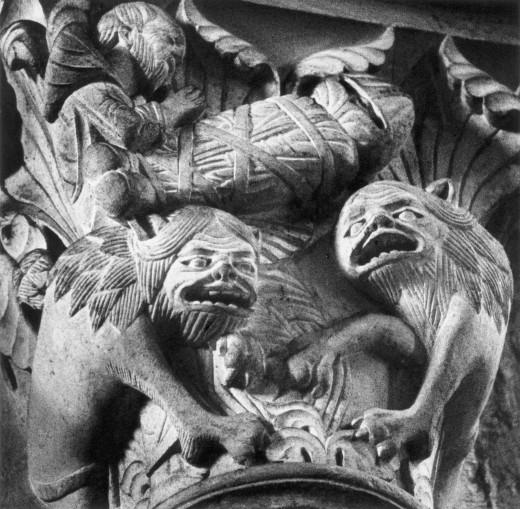 Figures on a capital, Sainte-Madeleine Basilica, Vezelay, Burgundy, France : Stock Photo