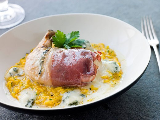 Chicken Breast wrapped in Parma Ham with Gorgonzola Cheese and Risotto Milanaise : Stock Photo
