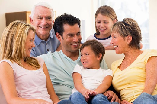 Extended family in living room smiling : Stock Photo