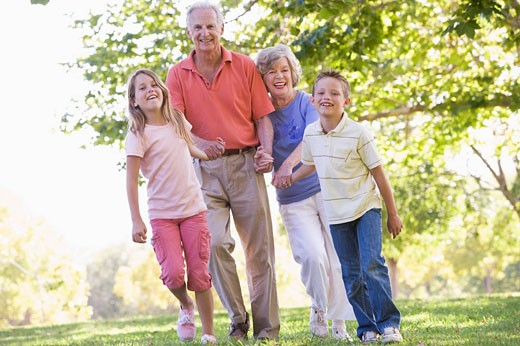 Grandparents walking with grandchildren. : Stock Photo
