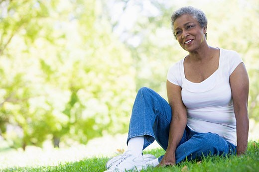 Senior woman resting in a park : Stock Photo