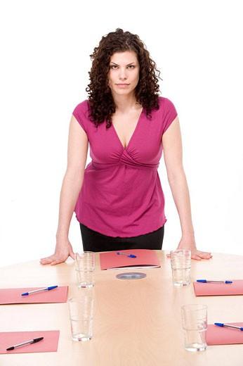 Businesswoman standing in boardroom : Stock Photo