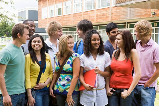 Group of students outdoors looking at camera smiling : Stock Photo