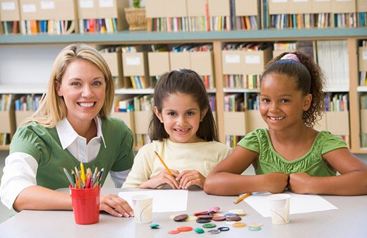 Two students in art class with teacher : Stock Photo