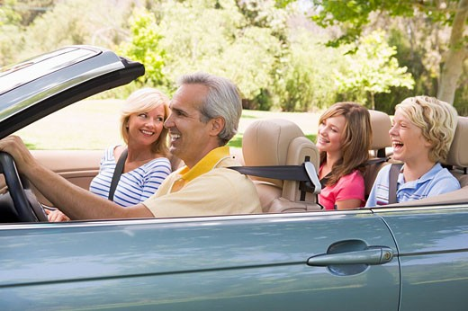 Family in convertible car smiling : Stock Photo