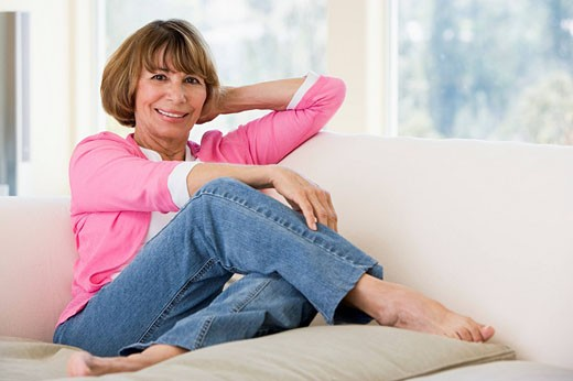 Stock Photo: 1888R-13431 Woman in living room smiling