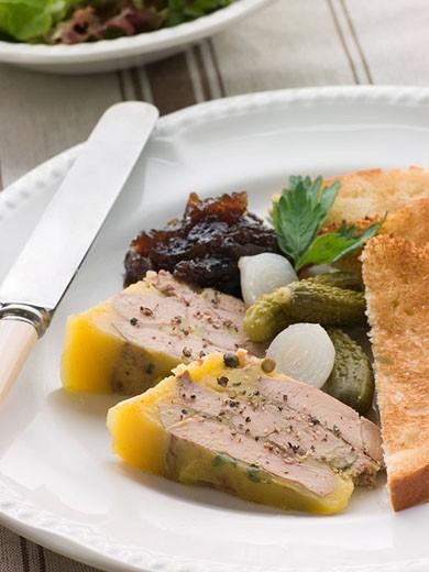 Stock Photo: 1888R-13671 Pressing of Foie Gras and Green Peppercorns with Cornichons Brioche and Onion Confit