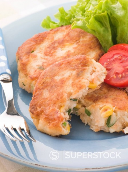 Cod and Salmon Fish Cakes with Corn and Salad : Stock Photo