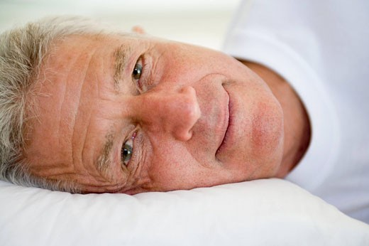 Man lying in bed : Stock Photo