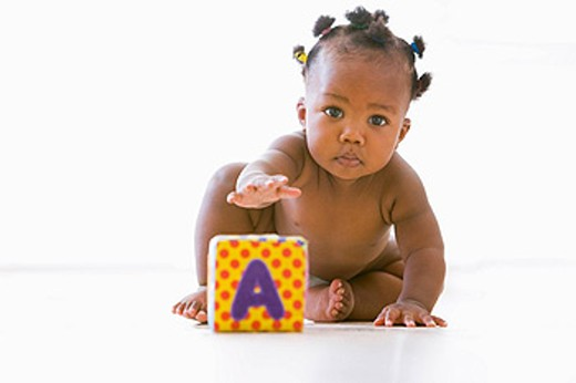 Stock Photo: 1888R-15895 Baby playing with block