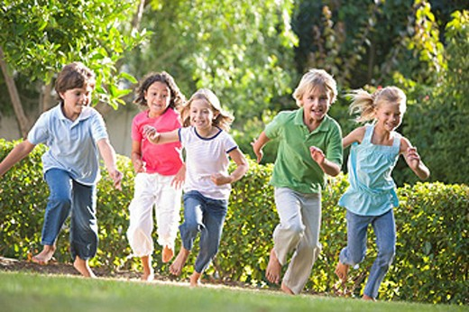 Five young friends running outdoors smiling : Stock Photo