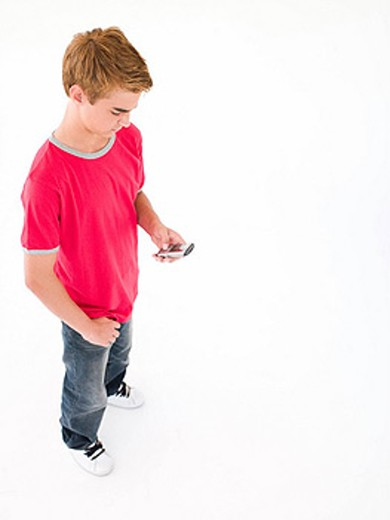 Young boy using cellular phone : Stock Photo