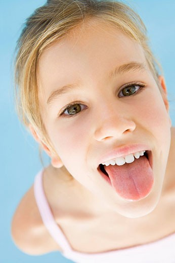 Stock Photo: 1888R-18125 Young girl sticking her tongue out