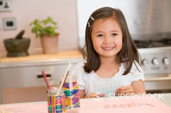 Stock Photo: 1888R-18424 Young Girl Drawing Pictures