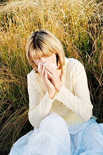 Woman Blowing Her Nose : Stock Photo